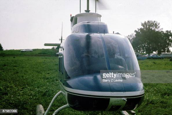 View of a helicopter on the grounds of the Woodstock Music and Arts Fair in Bethel New York August 15 17 1969 Helicopters were used by the festical...