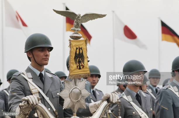 View of a honor guard of West German Bundeswehr troops standing to attention as they await the arrival of Emperor Hirohito of Japan at Cologne Bonn...