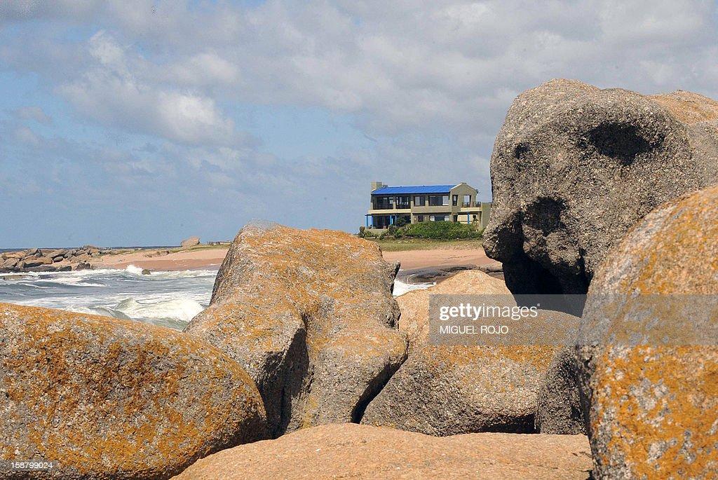 View of a house from the rocks in Jose Ignacio, Maldonado, Uruguay on December 27, 2012. AFP PHOTO/Miguel ROJO