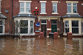 A view of a house with Christmas decorations on Warwick Road where rescue workers continue to evacuate people from their homes after Storm Desmond...