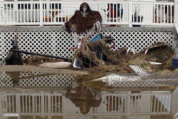 A view of a house with Halloween decorations in Breezy Point Queens after homes were destroyed by a fire during Hurricane Sandy in New York on...