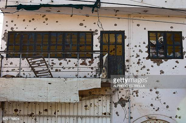 View of a house with hundreds of bullet holes in Cualican Sinaloa state Mexico on December 7 2016 On December 11 2016 Mexico marked 10 years since...