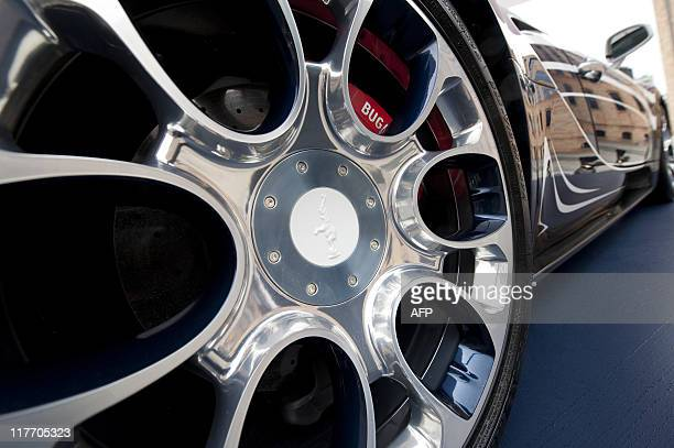 View of a hubcap on a newlyunveiled Bugatti Veyron 164 Grand Sport 'L'Or Blanc' in Berlin on June 30 2011 The luxury sports car designed in...