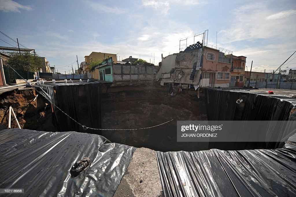 View of a huge crater taken on June 15, 2010, caused by a landslide due to tropical storm Agatha in Guatemala City. AFP PHOTO / Johan ORDONEZ