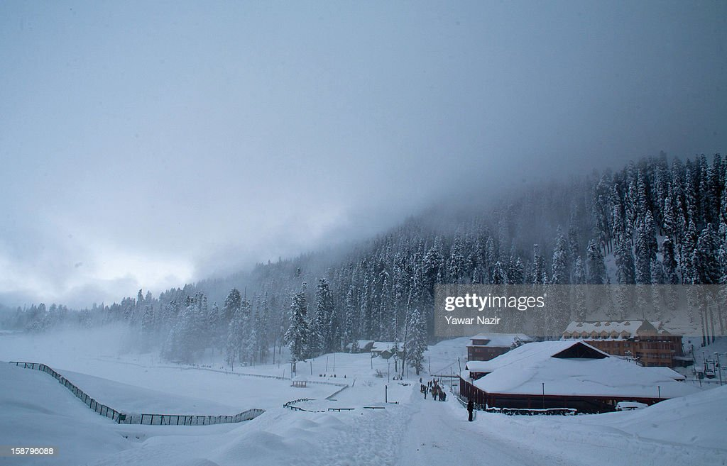 A view of a hutment covered in snow on December 29, 2012 in Gulmarg, 54 km (35 miles) to the west of Srinagar, the summer capital of Indian-administered Kashmir, India. With the second round of heavy snowfall in Kashmir valley, skiers from around the globe have descended on the ski resort of Gulmarg, known for long-run skiing, snow-boarding, heli-skiing and steep mountains. Gulmarg is located less than six miles from the ceasefire line or Line of Control (LoC) that divides Kashmir between India and Pakistan. As a sense of normalcy has started to return to this strife-torn region, various foreign governments, including the United Kingdom, have lifted the travel advisory to its citizens traveling to Kashmir, raising the hopes of the local tourism industry, officials said.