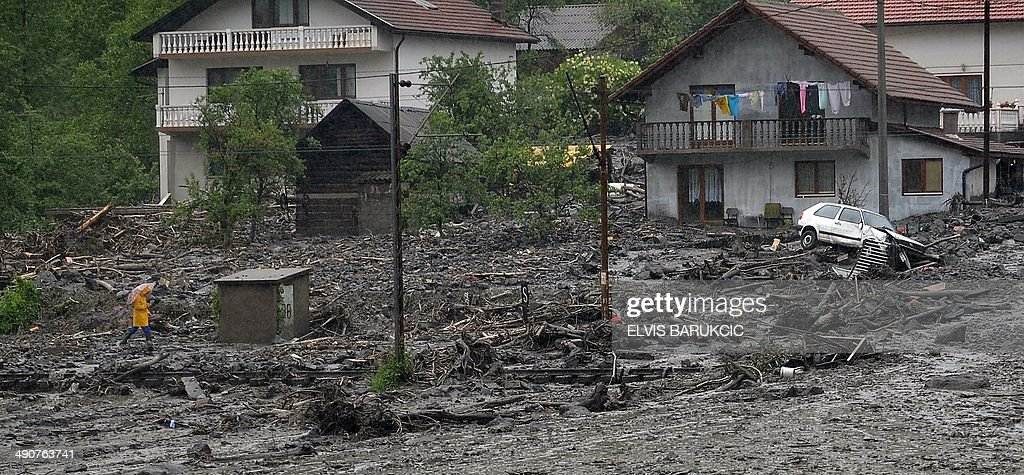 A view of a landslide and floodwaters around houses in the village of Topcic Polje near the central Bosnian town of Zenica on May 15 2014 Severe...