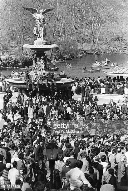 View of a large crowd of people gathered at Central Park's Bethesda Fountain New York New York April 12 1970