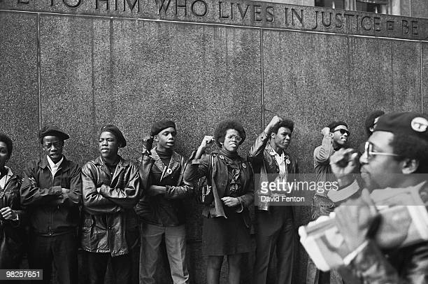 View of a line of Black Panther Party members as they demonstrate fists raised outside the New York City courthouse New York New York April 11 1969
