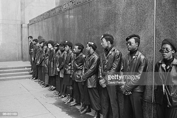 View of a line of Black Panther Party members as they demonstrate outside the New York City courthouse New York New York April 11 1969