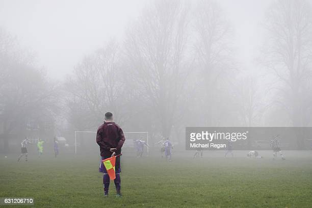A view of a linesman in the fog during a park football match ahead of the Emirates FA Cup Third Round match between Preston North End and Arsenal at...