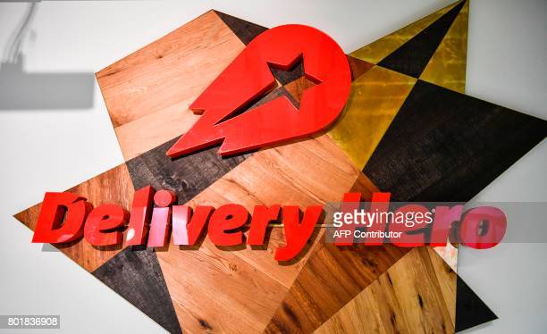 A view of a logo in a lounge area of the global headquarters of online food ordering and delivery giant Delivery Hero is pictured in Berlin on June...
