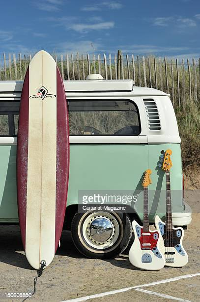 A view of a longboard and two Fender Jaguar electric guitars resting on a VW camper van session for Guitarist Magazine taken on July 1 2011