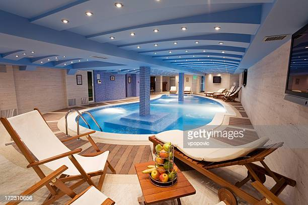 A view of a luxury pool with seating