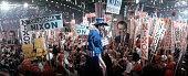 View of a man dressed as Uncle Sam entertaining a crowd holding Nixon signs at the 29th Republican National Convention in Miami Florida August 58 1968