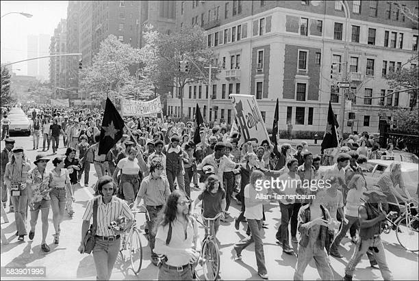 View of a man in Richard Nixon mask at Marijuana SmokeIn and March from Washington Square to Central Park New York New York May 30 1974