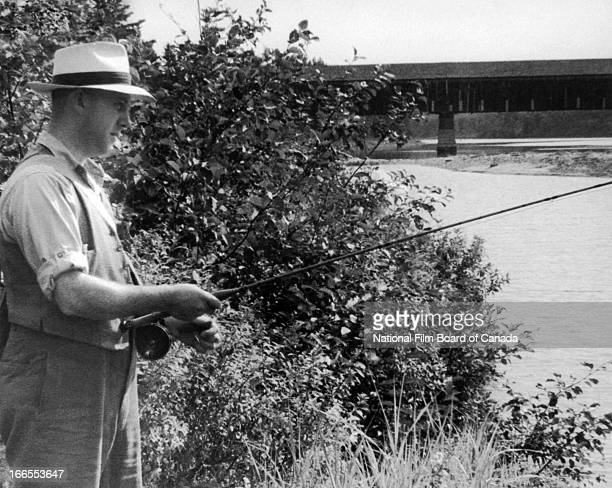 View of a man line fishing on the banks of a river Ontario Canada 1949 Photo taken during the National Film Board of Canada's production of 'Land in...