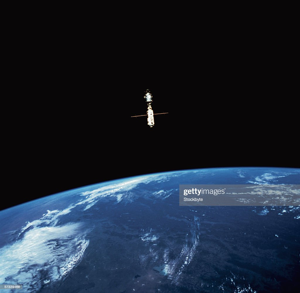 view of a manmade satellite in orbit above the earth