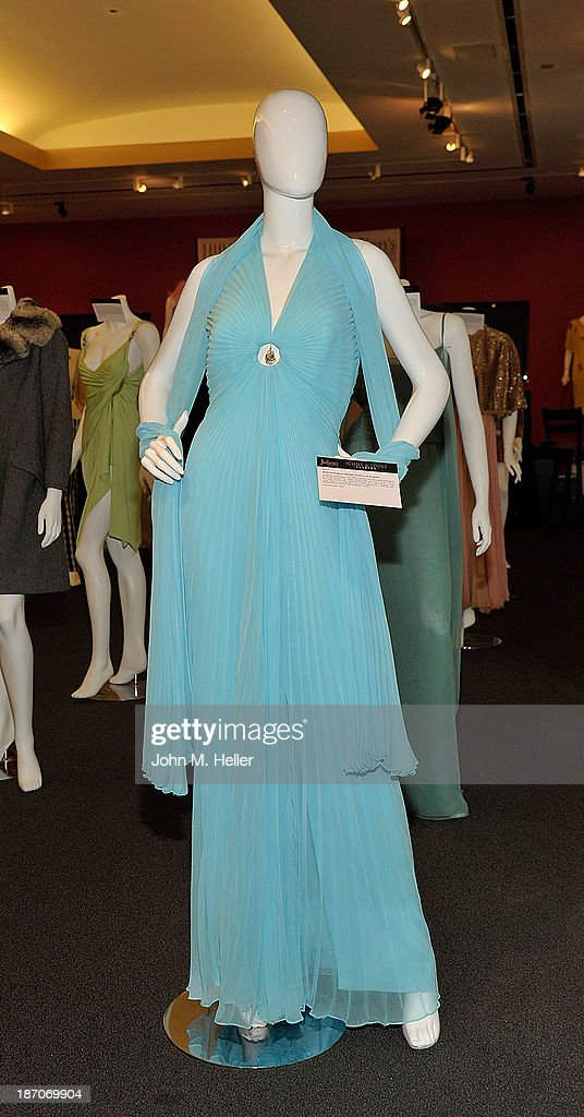 A view of a Marilyn Monroe inspired Travilla blue gown at the press preview for Icons & Idols Fashion and Hollywood Exhibit at Julien's Auctions Gallery on November 5, 2013 in Los Angeles, California.