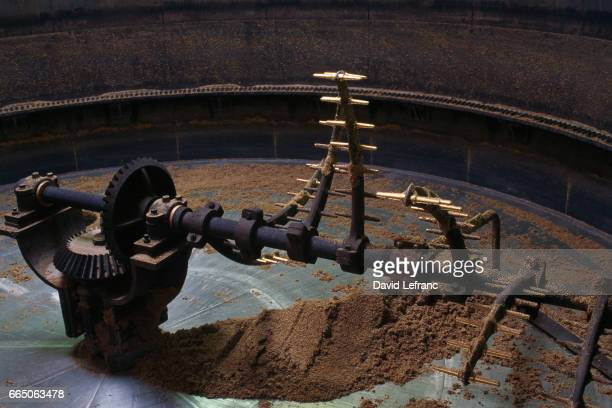 View of a mash tun a vessel in which mashing takes place The mash tun acts as a huge sieve where the grist is mixed with hot water and mashed into a...