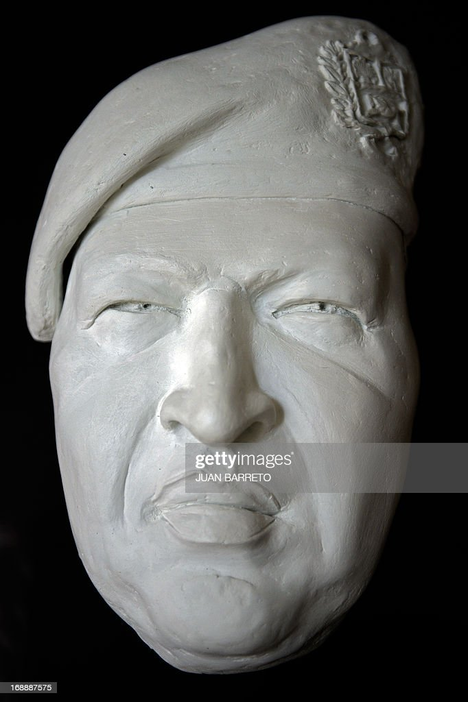View of a mask representing deceased Venezuelan President Hugo Chavez which is placed in a corridor of the Ministry of Foreign Affairs in Caracas on May, 16, 2013. AFP PHOTO
