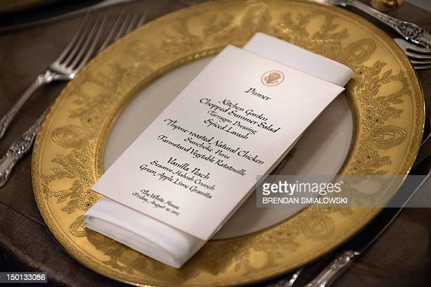 A view of a menu for an Iftar dinner in the State Dining Room of the White House is seen on August 10 2012 in Washington US President Barack Obama...