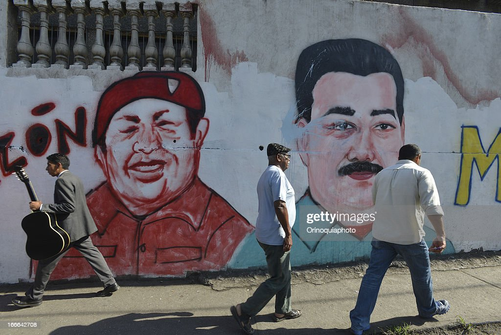 View of a mural in honor of Nicolas Maduro and hugo Chavez near a voting center during venezuelan presidential elections on April 14, 2013 in Caracas, Venezuela. Nicolas Maduro, political heir of the late Venezuelan President Hugo Chavez, competes with opposition candidate Henrique Capriles.