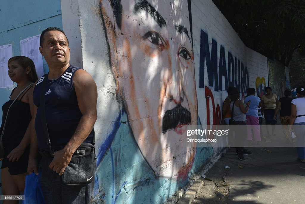 View of a mural in honor of Nicolas maduro during the venezuelan presidential elections on April 14, 2013 in Caracas, Venezuela. Nicolas Maduro, political heir of the late Venezuelan President Hugo Chavez, competes with opposition candidate Henrique Capriles.
