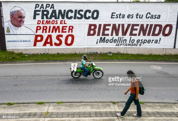 View of a mural reading 'Pope Francis let's take the first step This is your home Welcome Medellin waits for you' ahead of Pope Francis' upcoming...