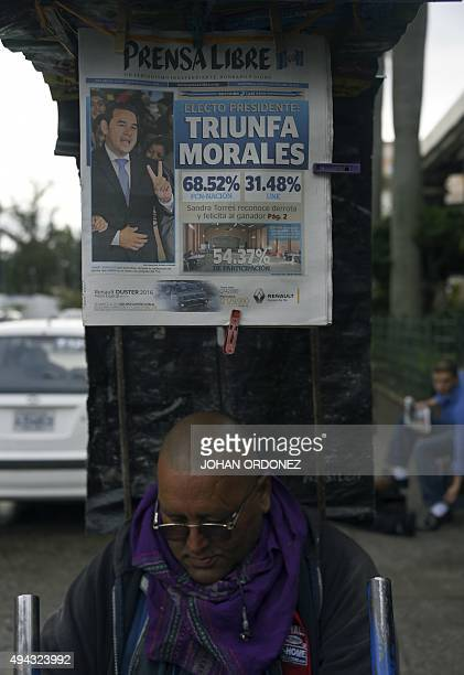 View of a newspaper front page in Guatemala city on October 26 the day after general elections Jimmy Morales a comic actor and TV personality...