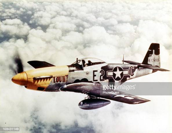 View of a North American P51D Mustang of the 8th Air Force in flight over England ca1940s Note the auxiliary fule tanks under the wing