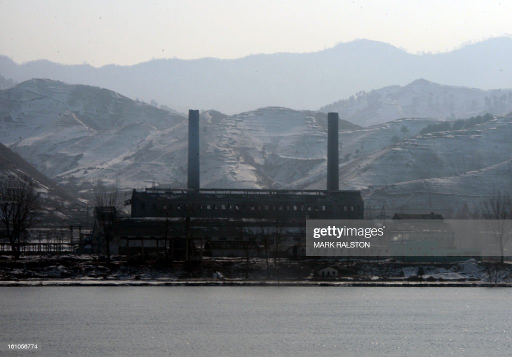 View of a North Korean factory at the town of Ch'ongsudong-Chung-ni taken from the Chinese town of Hekoucun on February 9, 2013. US Secretary of State John Kerry warned that North Korea's expected nuclear tests only increase the risk of conflict and would do nothing to help the country's stricken people. The country has vowed to carry out a third nuclear test soon, and concerns have been raised over the type of fissile material used in the device. AFP PHOTO/Mark RALSTON