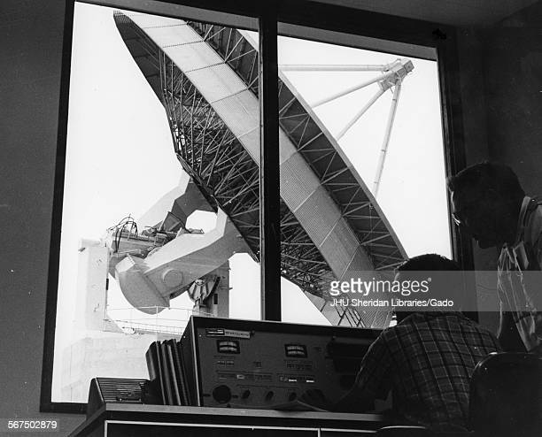 View of a pair of unidentified technicians in the satellite command and telemetry station at Johns Hopkins' Applied Physics Laboratory 1970 Outside...