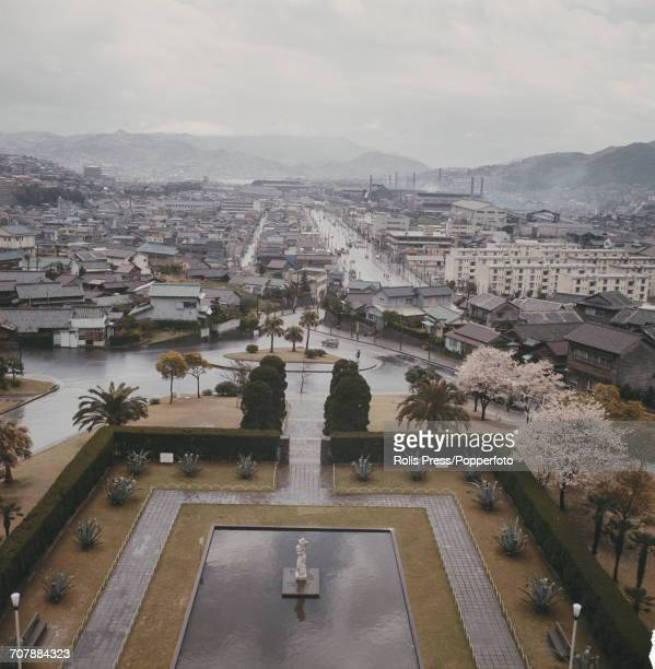 View of a park residential houses factories and industrial buildings in the city of Hiroshima on the island of Honshu in Japan in 1965 twenty years...