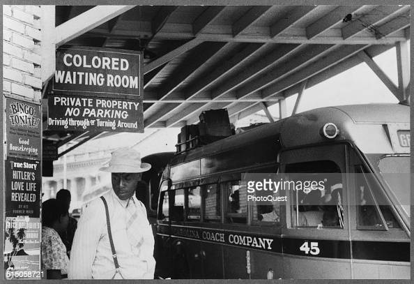 Photo taken at the bus station showing the Jim Crow signs of racial segregation Durham North Carolina May 1940