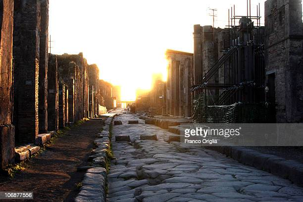 A view of a paved street on November 14 2010 in Pompeii Italy Pompeii is a partially buried Roman towncity near modern Naples The Schola Armatorum a...