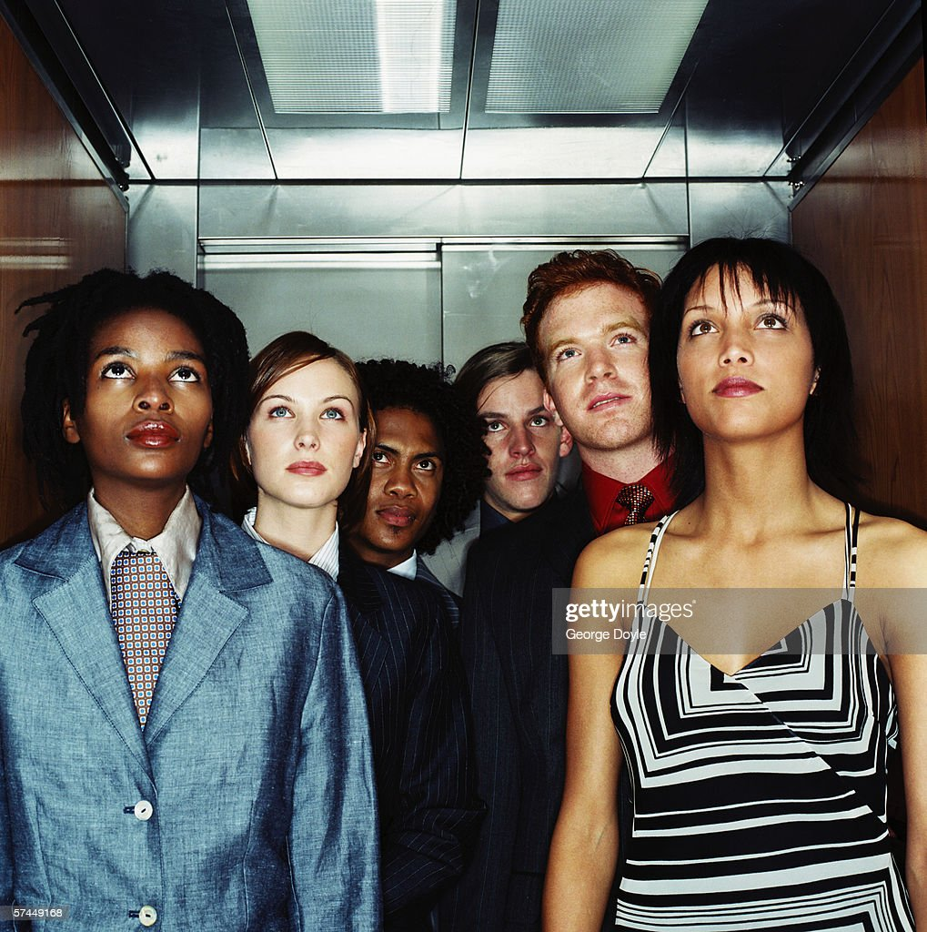 view of a people looking at the floor display in an elevator : Stock Photo