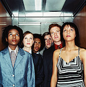 view of a people looking at the floor display in an elevator