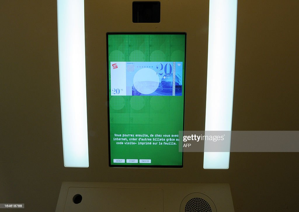 View of a photo booth where visitors can have a fake bank note printed with their own portrait on it on March 25, 2013 prior to the opening of the exhibition 'L'Economie: krach, boom, mue ?' at the Cite des Sciences in Paris