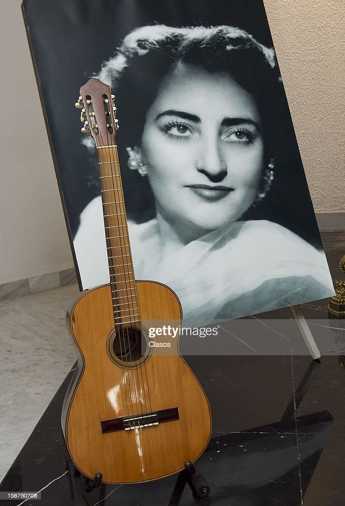 View of a photograph and a guitar of Ema Elena Valdemar during the funeral of the Mexican composer on December 24, 2012 in Mexico City, Mexico.