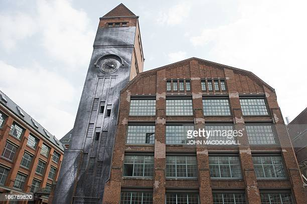 A view of a photograph posted on a wall by French graffiti artist and selfcoined 'photograffeur' JR is pictured in Berlin on April 16 2013 The artist...