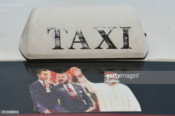 A view of a picture of Mohammed VI of Morocco with his son seen on one of the taxi in Rabat's city center On Friday June 30 in Rabat Morocco