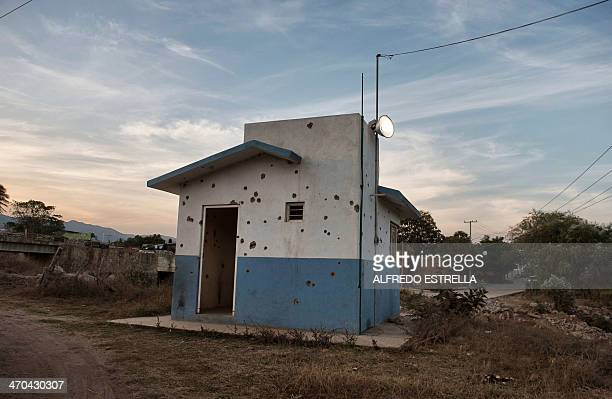 View of a police check point in a road to a steel mine in the Aguililla community in Michoacan State Mexico on February 14 2014 Next February 24...
