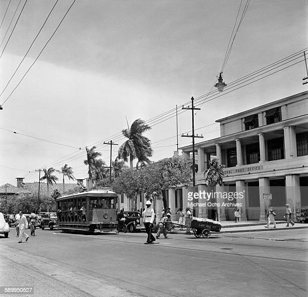 A view of a policeman directing traffic in front the post office in Kingston Jamaica