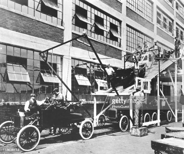 View of a portion of the assembly lIne for Model T automobiles at a Ford manufacturing plant 1913