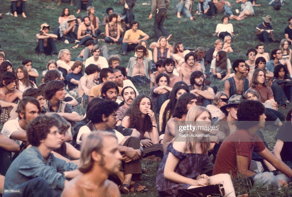 View of a portion of the audience as they watch a performance at the Woodstock Music and Arts Fair Bethel New York August 1969 The festival ran from...