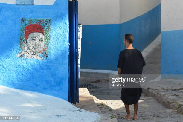 A view of a portrait of Mohammed VI of Morocco in one of many narrow street inside Rabat's Kasbah of the Udaya On Friday June 30 in Rabat Morocco