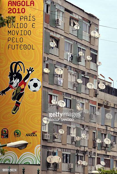 A view of a poster displaying Palaquinha the official mascot of the 2010 African Cup of Nations football tournament near a building on January 20...