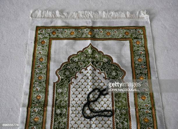 View of a prayer mat and prayer beads prior to an inaugural friday payer at the Ibn RushdGoethemosque in Berlin on June 16 2017 Founded by Seyran...