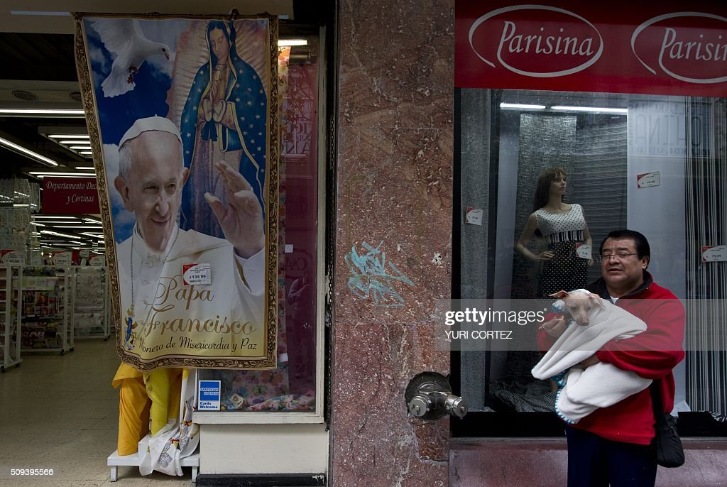 View of a printed cloth displaying an image of Pope Francis and the Virgin of Guadalupe in Mexico City on February 10, 2016. Pope Francis will visit four Mexican states from next February 12 to 17. AFP PHOTO / YURI CORTEZ / AFP / YURI CORTEZ