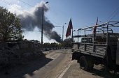 View of a proRussian separatist checkpoint as smoke rises from the airport area in the background in Donetsk October 2 2014 The airport held by...